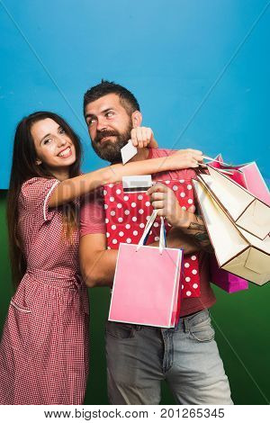 Guy With Beard And Lady With Happy Faces Do Shopping