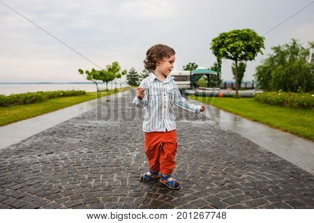 The Boy Is Walking In The Park.