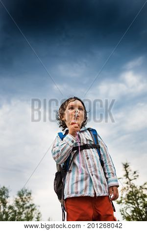 Boy Is Playing With Soap Bubbles.