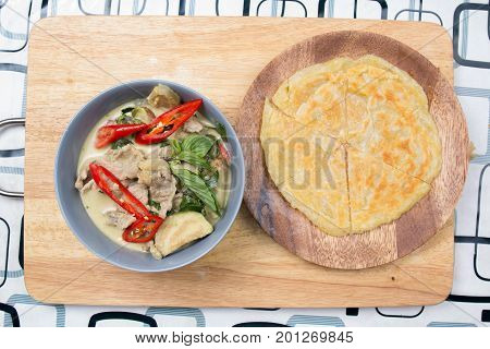 Beef green curry served with roti / Cooking green curry concept