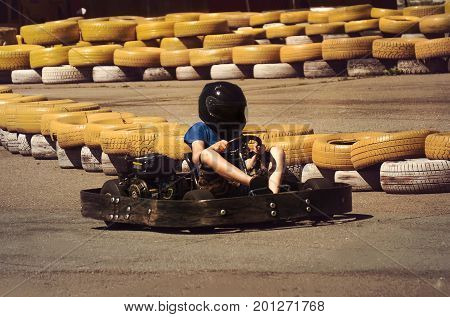 A Man Is Driving Go-kart With Speed In The Park