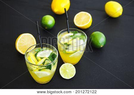 Cold and refreshing lemonade with lemon and limes. Fresh tasty lemonade