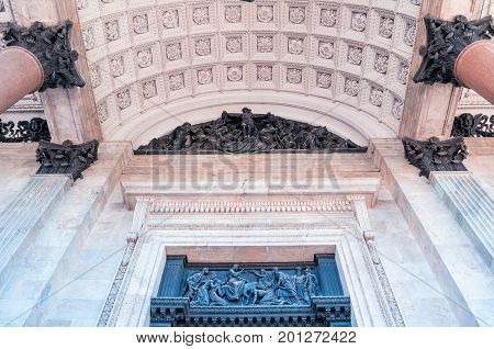 Architecture backgorund colonnade capitals ceiling and sculptures of the St Isaac Cathedral in St Petersburg Russia. Architecture detail view of St Petersburg architecture landmark