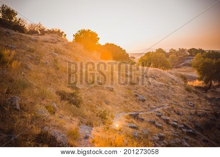 Ruins Of Ancient Amphitheatre In Erytrai Turkey View In Sunset Rays Of Sun