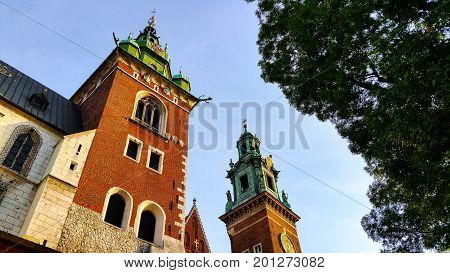 Domes of two Renaissance chapels on the side of the cathedral on Wawel Hill in Krakow Poland. Poland's monarchs used to be crowned here. The chapel with the golden dome is Kaplica Zygmuntowska