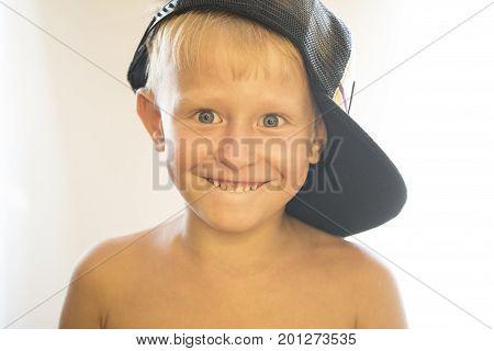 Portrait Of A Naked Little Boy In A Cap.