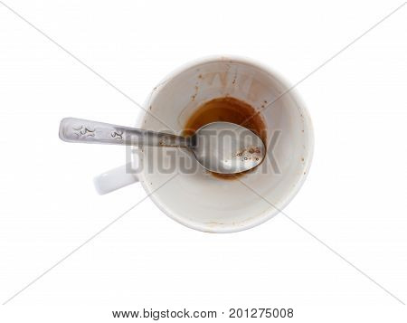 Empty white coffee cup after drink with Sugar at the bottom of the cup on white background - top view
