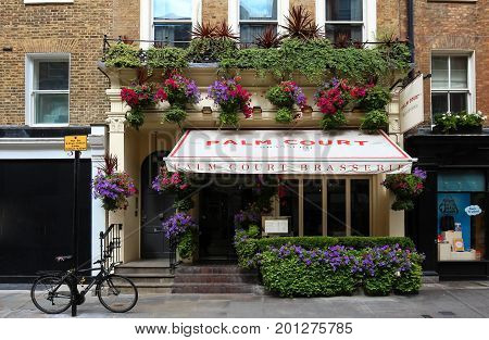 LONDON, ENGLAND-August 15, 2017: The exterior of Palm Court brasserie in the heart of Covent Garden , London, England. It is the quintessential, intimate Parisian-style brasserie.
