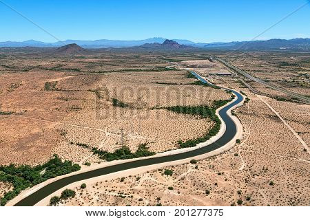 Aerial view of the Arizona Canal winding through east Mesa with the Beeline Highway to the south and Red Mountain in the distance