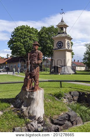 OSTERBYBRUK, SWEDEN ON JUNE 25. View of an artwork of a blacksmith this side the belfry on June 25, 2017 in Osterbybruk, Sweden. Artwork by Hans Gustafsson. Editorial use.