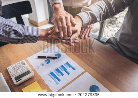Teamwork process Image of business people joining and putting hands together during their meeting connection and Collaboration concept.