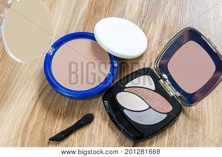 Women's cosmetics - powder and shadows in the package