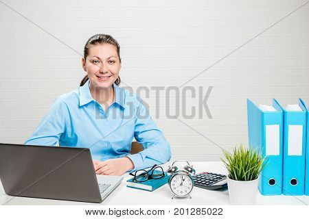Young Accountant At The Desk In The Office With Laptop