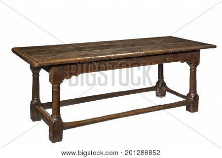 Original old antique seventeenth century oak refectory dining table isolated on white with clipping path