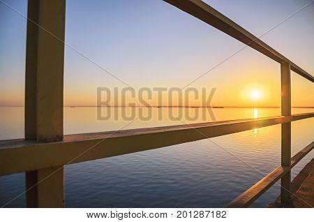 Beautiful Sunset At Rio Parana River Between The Metal Structure