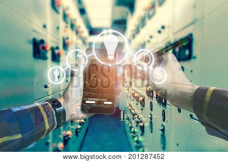 Double exposure photo hand touching mobile phone for using business tool iconsInvestment manager with electrical room background for stock trading concept.