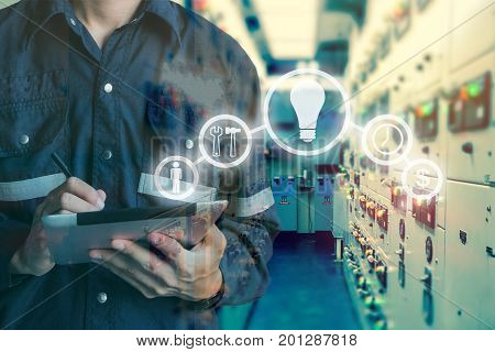 Double exposure of Engineer or Technician man using tablet in switch gear electrical room oil and gas platform or plant industrial with tools icon business and electrical industry concept.