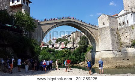 Mostar, Bosnia and Herzegovina - July 25, 2017: Peoples on the reconstructed Old Bridge of Mostar on river Neretva, Bosnia and   Herzegovina
