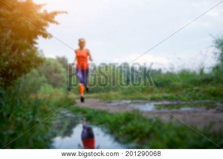 Blurred photo of running sportswoman