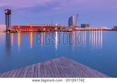 View of the seaport and the city embankment at sunset. Barcelona. Spain.