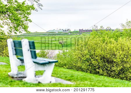 Empty Bench In Green Plaines D'abraham In Morning During Summer With View Of Citadelle In Quebec Cit
