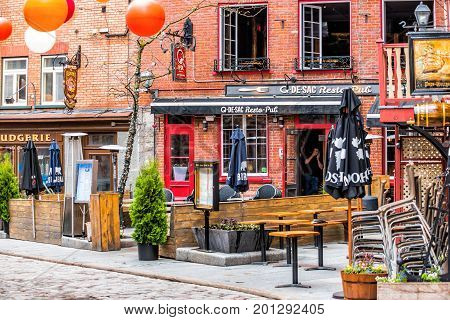 Quebec City, Canada - May 30, 2017: Lower Old Town Cobblestone Street Called Sous Le Fort With Resta