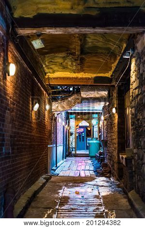 Quebec City, Canada - May 31, 2017: Old Town Street Narrow Dark Brick Alleyway With Path To Belle Gu
