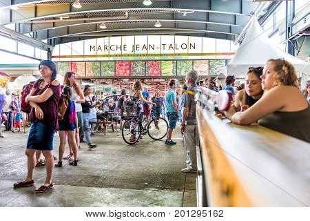 Montreal, Canada - May 28, 2017: Jean Talon Market Sign And Entrance With People In Little Italy Nei