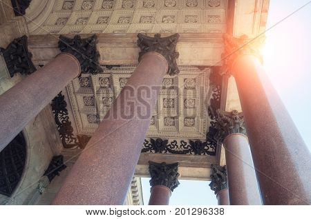 Architecture landscape of St Petersburg Russia landmark. St Isaac Cathedral colonnade in St Petersburg Russia. Architecture background of St Petersburg landmark with columns under sunlight