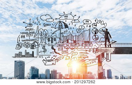 Businessman in suit drawing business-analytical strategy while standing on broken bridge with cityscape and sunlight on background. 3D rendering.