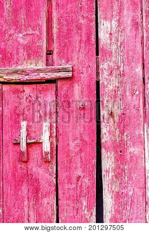 Abstract Closeup Pattern Of Red Painted Old Vintage Shed Door With Handle In Countryside
