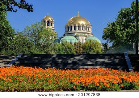 Alexander Nevsky Cathedral in Sofia framed by the trees and colorful flowers of surrounding parks, Bulgaria
