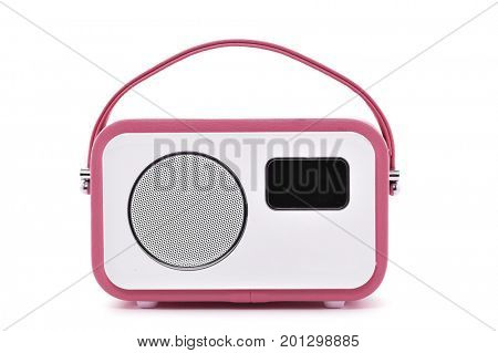 closeup of a retro-styled pink and white radio receptor on a white background