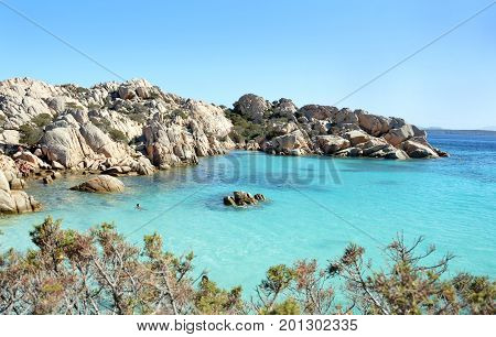 Archipelago Maddalena, Caprera Island, Cala Coticcio beach. heaven on earth.             Corner of paradise in the Mediterranean Sea on the archipelago of Maddalena, lovely beach with clear and blue waters, uncontaminated framed of suggestive rocks