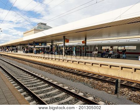 MANNHEIM GERMANY - AUG 8 2017: Large group of people waiting at the train station platform in Mannheim hauptbahnhof Train station commuting in German