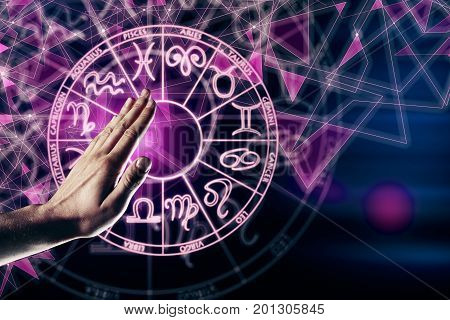 Hand with zodiac sign horoscope circle. Future and aquarius concept