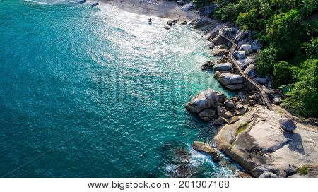 Stones on the beach with clear blue sea