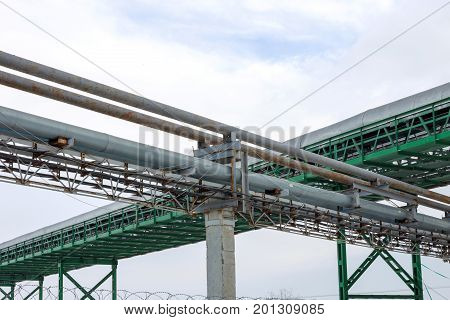 Fragment Metal Grain Elevator In Agricultural Zone. Agricultural Silos. Building Exterior. Storage A