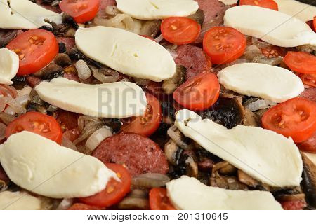 Closeup View Of Homemade Pizza With Ingredients Ready For Baking