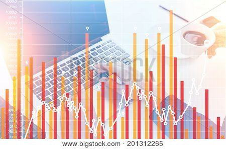 Close up of businesswoman s hands typing on her laptop keyboard while an assistant is fetching coffee. Red graphs in the foreground. Toned image double exposure