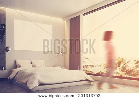 Gray and concrete bedroom interior with a concrete floor a gray bed and a large horizontal poster hanging above it. Side view woman. 3d rendering mock up toned image double exposure