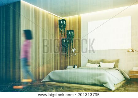 Gray and wooden bedroom interior with a wooden floor a gray bed and a large horizontal poster hanging above it. Woman corner. 3d rendering mock up toned image double exposure