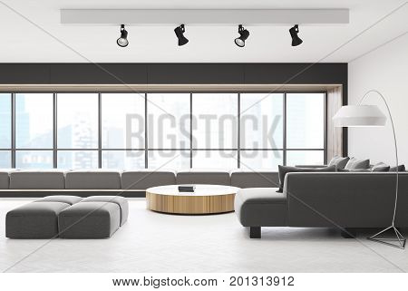 White and wooden living room with a wooden floor a round narrow table and gray sofas. There is a panoramic window with soft cushions on the window sill. Side view. 3d rendering mock up