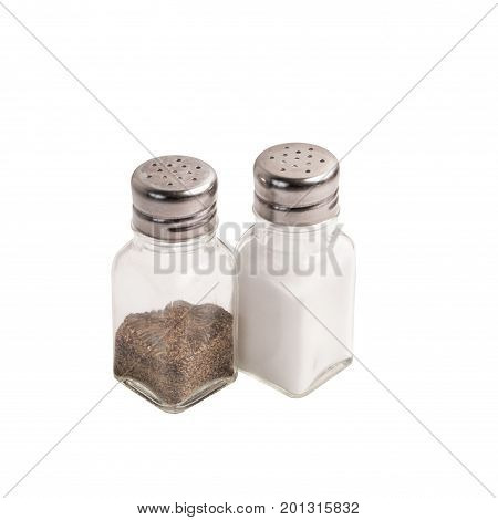 Ordinary household salt and pepper shakers isolated against a white background.