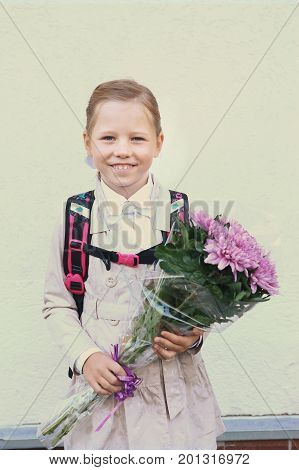 Moscow, Russia,September 1,2016: Unidentified first grade school kids with flowers bouquet celebrate their first school day before going to classes in Moscow, September 1, 2016.
