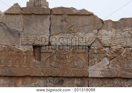Ahura Mazda - Persian Bas-relief In Persepolis, Iran. Ancient Persian Art, Sculpture In Iran. Zoroas