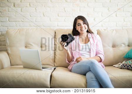 Gorgeous Woman With A Professional Camera