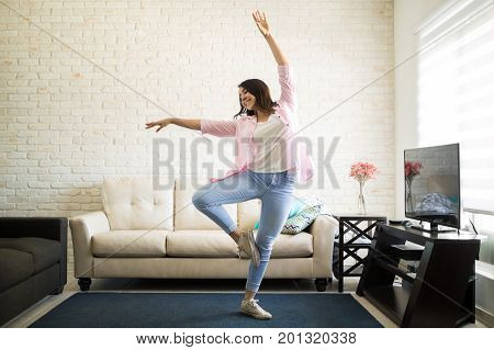 Single Woman Dancing In The New Apartment