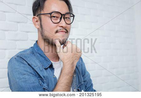 Attractive beautiful positive man - close up portrait asian nerdy man
