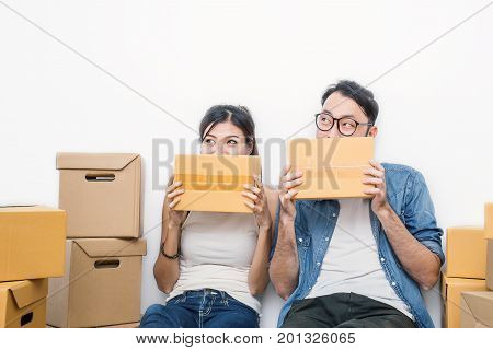 Start up small business entrepreneur SME or freelance woman and man which their hands holding box working at home concept online marketing packaging and delivery SME concept